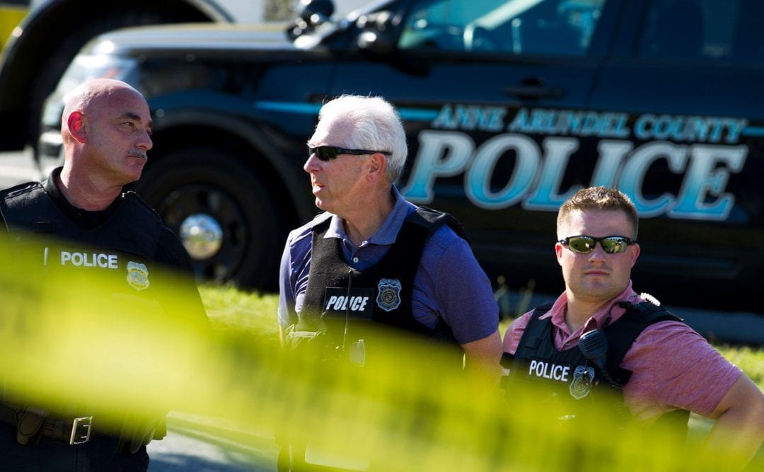 The suspected Maryland newspaper shooter had a history of harassing a woman
